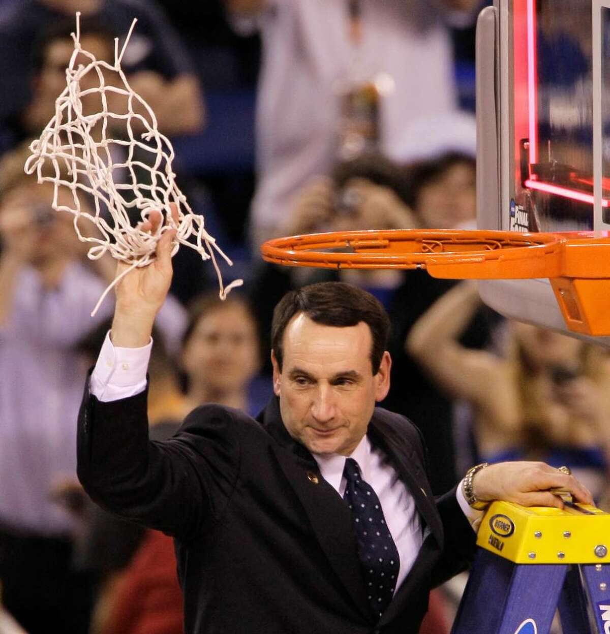 Duke head coach Mike Krzyzewski cuts down the net after Duke's 61-59 win over Butler in the men's NCAA Final Four college basketball championship game Monday, April 5, 2010, in Indianapolis.