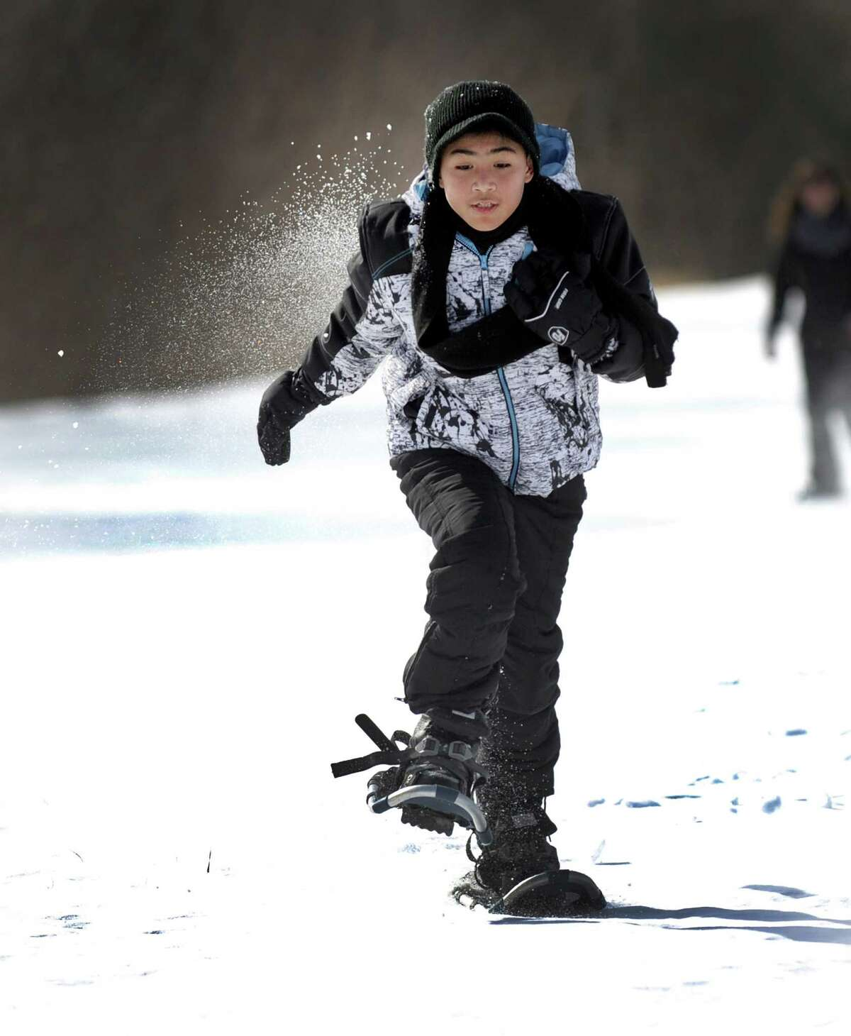 Julian Roman, a fifth-grader at Sarah Noble Intermediate School snowshoes on the fields of the school Friday, Feb. 12, 2016, with his class.The Pratt Nature Center is holding Snowshoe Project 2016. This is the second year the center is holding the event and plans to take all New Milford third, fourth and fifth-grade students snowshoeing starting on Friday, Feb. 12, 2016, at Scotts Ridge Intermediate School. The event aims to promote living a healthy and active lifestyle.
