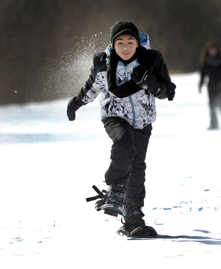 Julian Roman, a fifth-grader at Sarah Noble Intermediate School snowshoes on the fields of the school Friday, Feb. 12, 2016,  with his class.The Pratt Nature Center is holding Snowshoe Project 2016. This is the second year the center is holding the event and plans to take all New Milford third, fourth and fifth-grade students snowshoeing starting on Friday, Feb. 12, 2016, at Scotts Ridge Intermediate School. The event aims to promote living a healthy and active lifestyle. Photo: Carol Kaliff / Hearst Connecticut Media / The News-Times