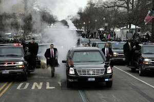 WASHINGTON, UNITED STATES:  Secret Service personnel keep apace of the presidential limousine during the  Inaugural Parade on Pennsylvania 20 January 2005 in Washington, DC. US President George W. Bush was sworn in for a second term under unprecedented security on the steps of the US Capitol.     AFP PHOTO/POOL/DOUG MILLS