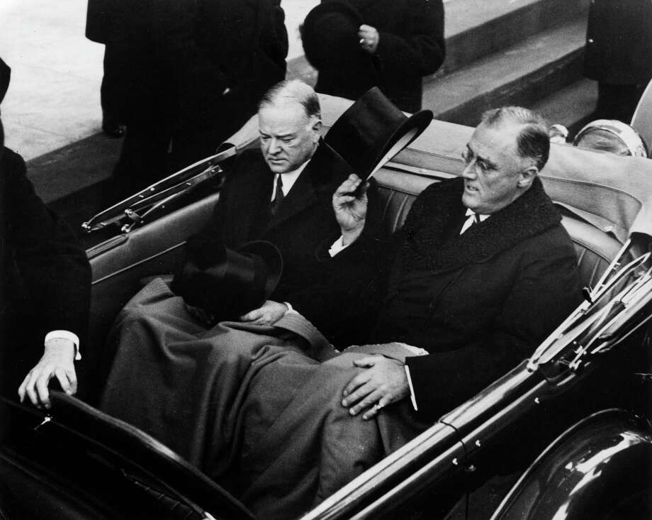In 1933, President Herbert Hoover (left) glowered as he rode with his replacement, President-elect Franklin D. Roosevelt.  Photo: American Stock Archive, Getty Images / Archive Photos