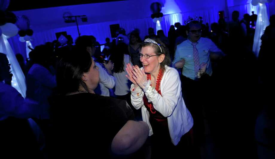 """Lore Knorr, of Brookfield, dances at the """"Night to Shine Prom."""" Photo: H John Voorhees III / Hearst Connecticut Media / The News-Times"""