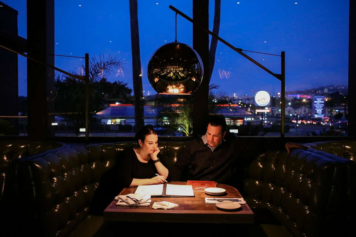 Co-owners Elena Duggan and John Duggan discuss the schedule of their grand opening at a booth in the main dining room of their family restaurant, Joe's of Westlake in Daly City, California on Tuesday, February 14, 2016.