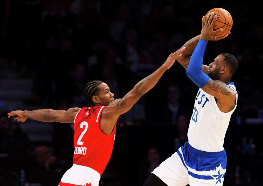 LeBron James, of the Cleveland Cavaliers, (23) makes a shot past Kawhi Leonard, of the San Antonio Spurs, (2) during the second half of the NBA All-Star Game in Toronto on Sunday. Photo: Mark Blinch /Associated Press / The Canadian Press