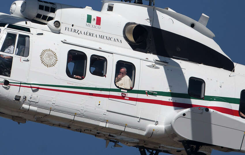 Pope Francis peers from the window of his helicopter as he arrives in San Cristobal de las Casas, Mexico, Monday, Feb. 15, 2016. Francis is celebrating Mexico's Indians on Monday with a visit to Chiapas state, a center of indigenous culture, where he will preside over a Mass in three native languages thanks to a new Vatican decree approving their use in liturgy. The visit is also aimed at boosting the faith in the least Catholic state in Mexico.