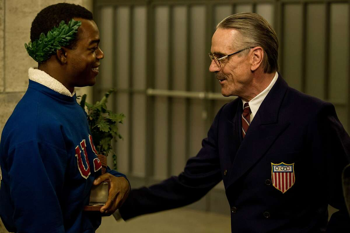 This photo provided by Focus Features shows Stephan James, left, as Jesse Owens and Jeremy Irons as Avery Brundage, in Stephen Hopkins'