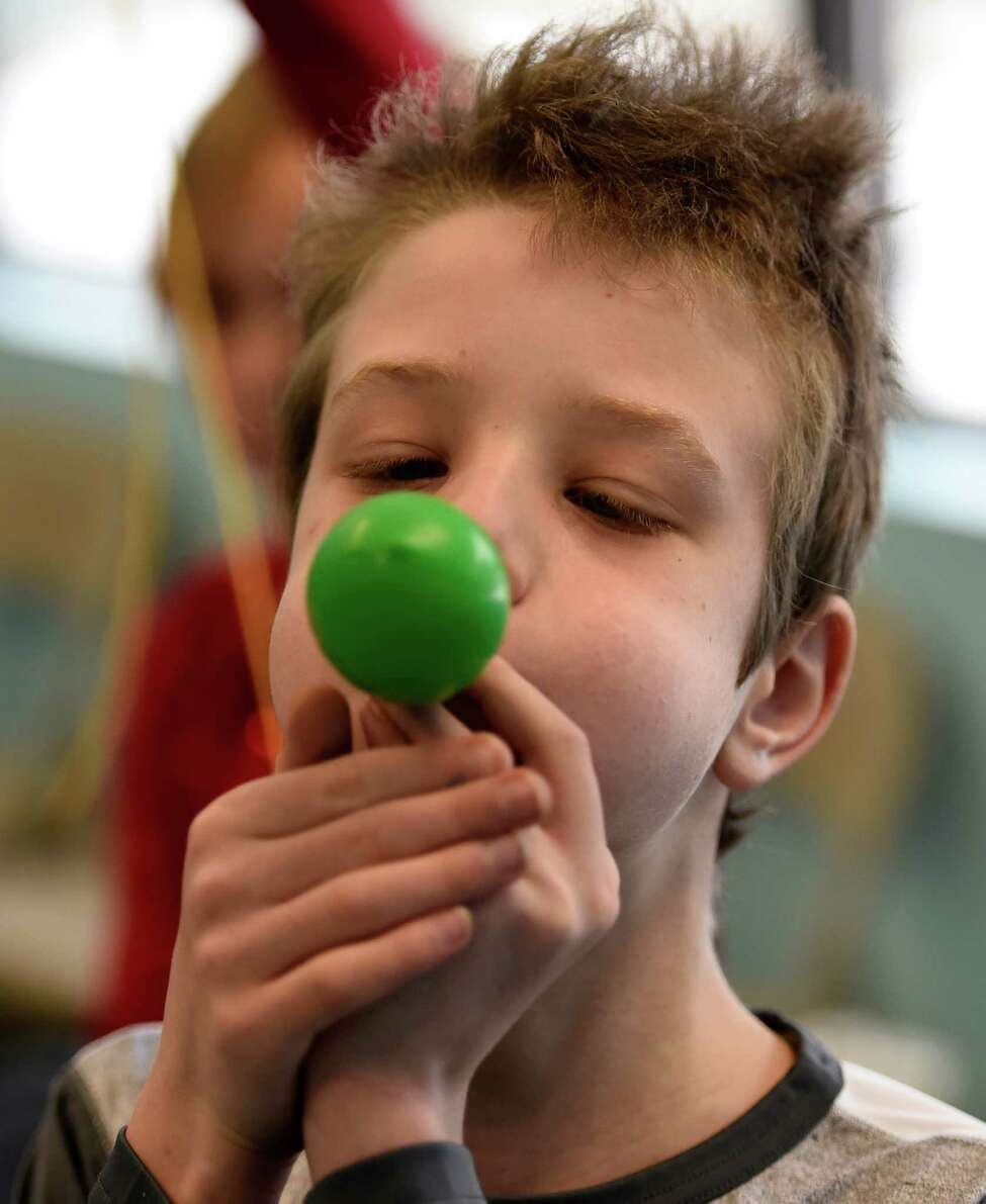 Asher Carlin, 11, of Albany blows up a balloon for his project during the Galileo's Gravity Games held at the Children's Museum of Science + Technology during School Break Camp Feb. 15, 2016, in Troy, N.Y. School Break Camp runs all this week during the winter break for schools in the area. (Skip Dickstein/Times Union)