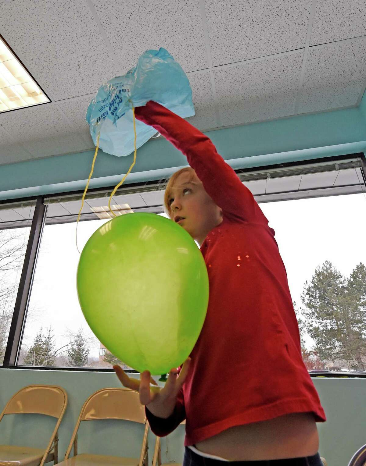 Elizabeth McDonald, 9, of Troy works on her gravity experiment during the Galileo's Gravity Games held at the Children's Museum of Science + Technology during School Break Camp Feb. 15, 2016, in Troy, N.Y. School Break Camp runs all this week during the winter break for schools in the area. (Skip Dickstein/Times Union)