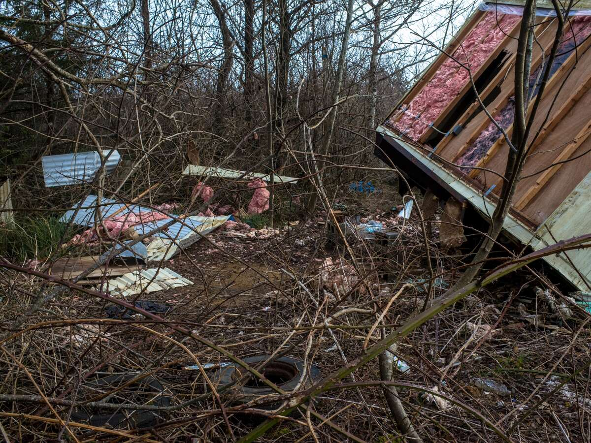 Insulation and siding lay strewn across the land after a wind storm distributed the insides of a recently toppled trailer at Washaway Beach.