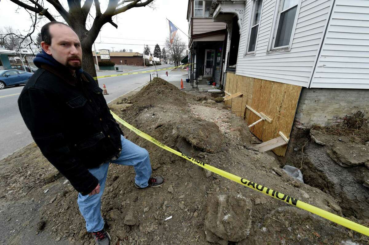 Homeowner Matthew Dolan looks at his foundation at 850 5th Avenue which is exposed for repairs after it was damaged in the recent water break Feb. 15, 2016 in Troy, N.Y. (Skip Dickstein/Times Union)