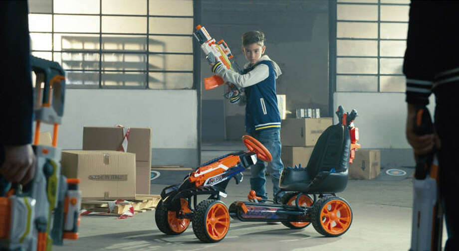 An innocent go-kart is transformed into an armory with Hauck Toys' new NERF Battle Racer powered by the user's push of the pedals. Photo: Nerf On Amazon