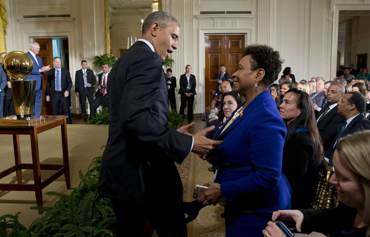 President Obama talks with Rep. Barbara Lee at a ceremony honoring the champion Golden State Warriors.