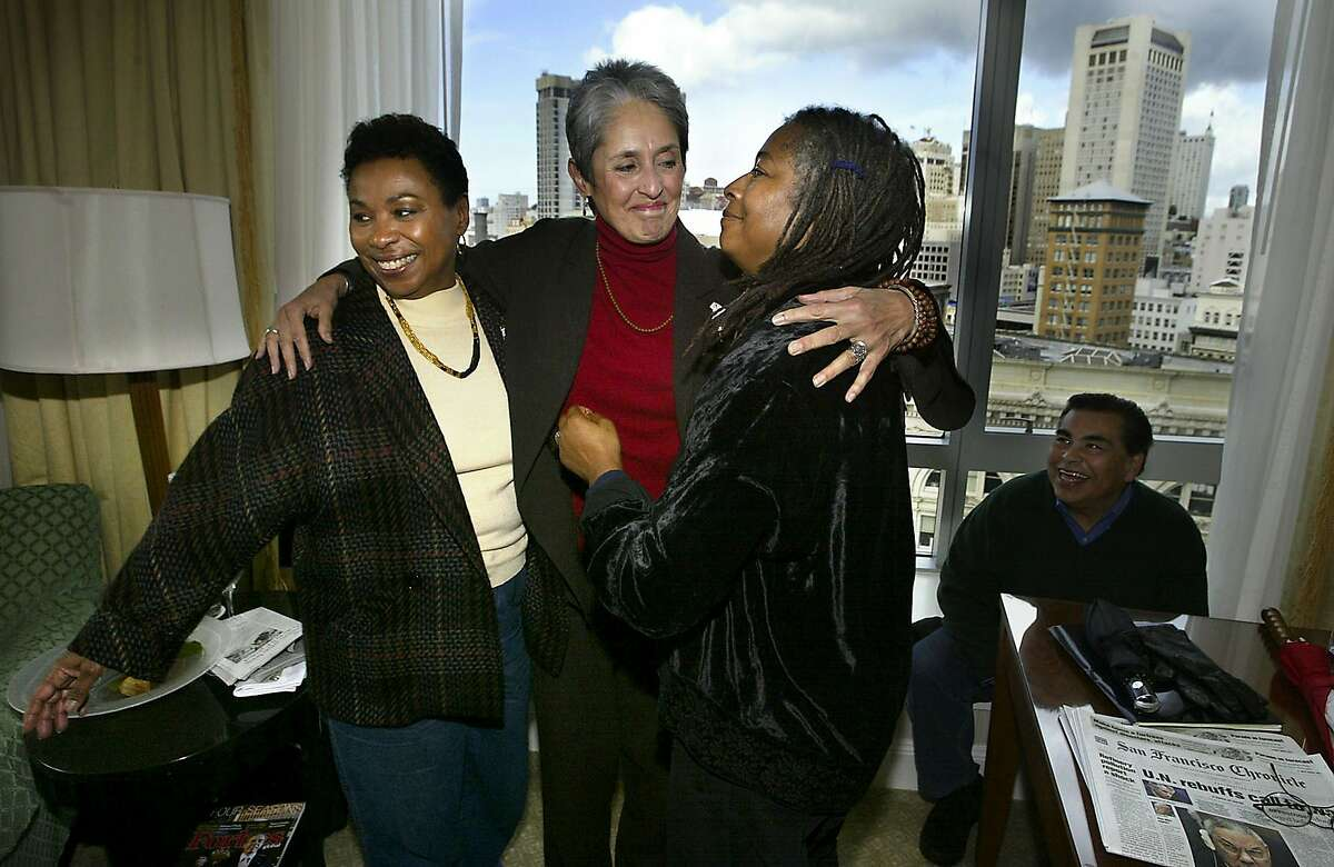 In a room in the Four Seasons Hotel, Congresswoman Barbara Lee, Joan Baez, and Alice Walker (left to right) greet each other as they meet before they go out onto Market Street for the Peace march.