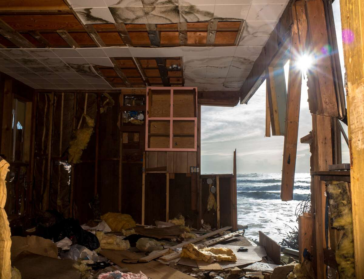 Once a charming little two story beach home is now a hallowed out mess at Washaway Beach.