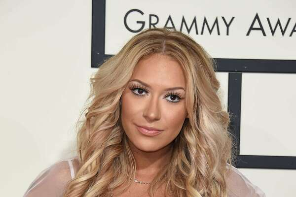Kaya Jones arrives on the red carpet for the 58th Annual Grammy music Awards in Los Angeles February 15, 2016. AFP PHOTO/ VALERIE MACONVALERIE MACON/AFP/Getty Images