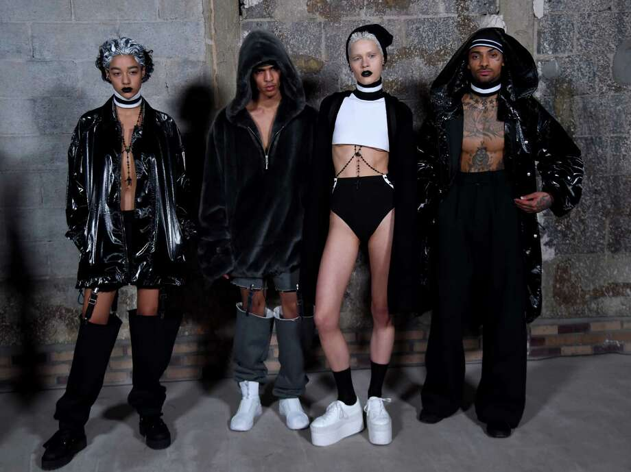 Models pose backstage at the Fenty Puma by Rihanna AW16 Collection during Fall 2016 New York Fashion Week at 23 Wall Street on February 12, 2016 in New York City. Photo: Jamie McCarthy /Getty Images For Fenty Puma / 2016 Getty Images