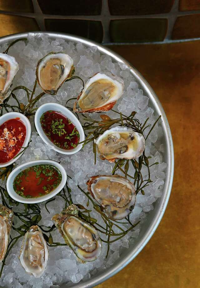 A platter of fresh oysters at the restaurant State of Grace, Wednesday, Feb. 10, 2016, in Houston. ( Mark Mulligan / Houston Chronicle ) Photo: Mark Mulligan, Staff / © 2016 Houston Chronicle