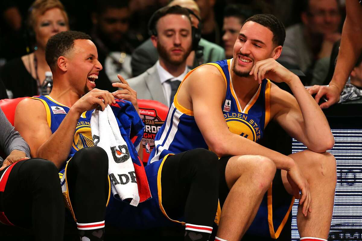 TORONTO, ON - FEBRUARY 13: Stephen Curry and Klay Thompson of the Golden State Warriors laugh on the bench in the Foot Locker Three-Point Contest during NBA All-Star Weekend 2016 at Air Canada Centre on February 13, 2016 in Toronto, Canada. NOTE TO USER: User expressly acknowledges and agrees that, by downloading and/or using this Photograph, user is consenting to the terms and conditions of the Getty Images License Agreement. (Photo by Elsa/Getty Images)