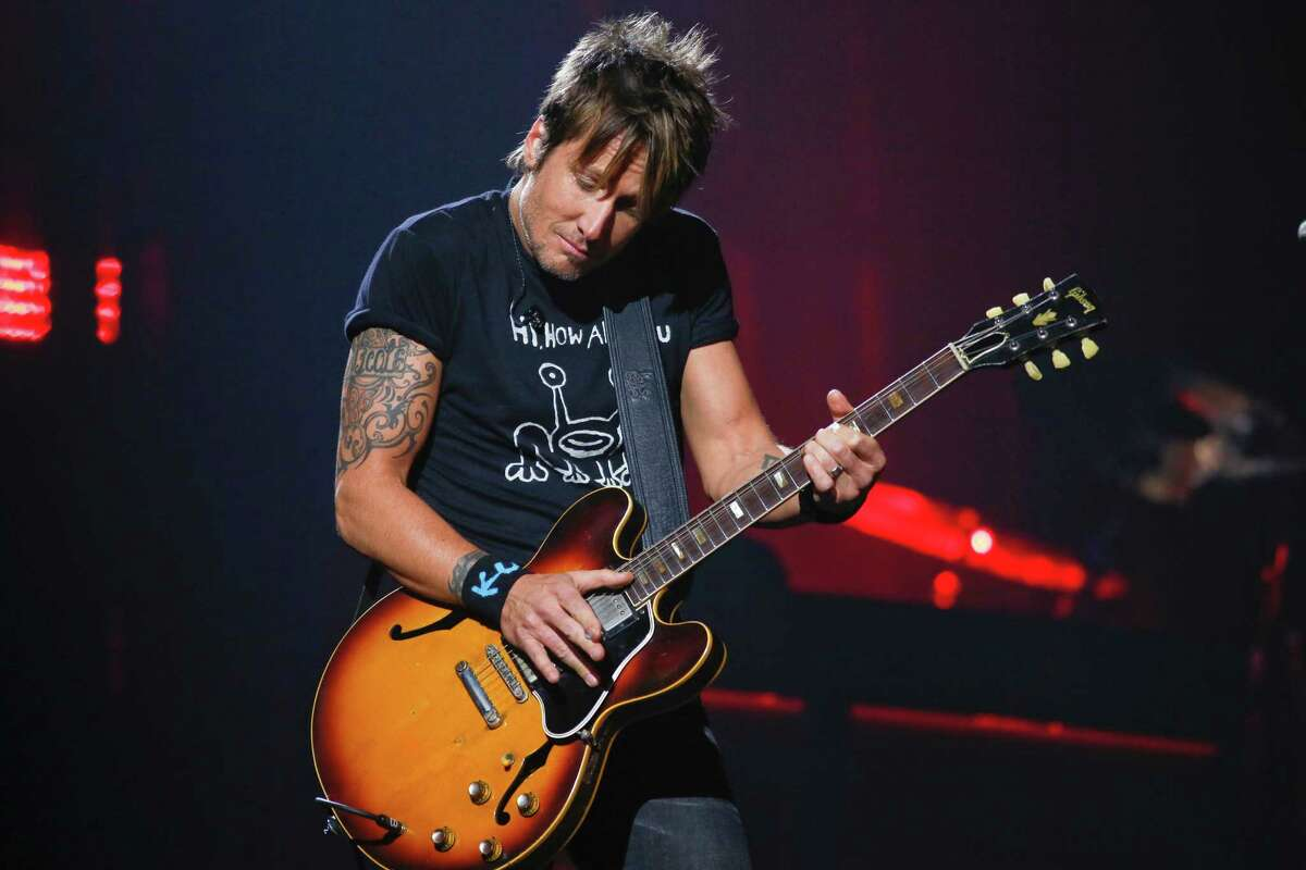 Keith Urban performs at the iTunes Festival during the SXSW Music Festival Saturday March 15, 2014, in Austin, Texas. (Photo by Jack Plunkett/Invision/AP)