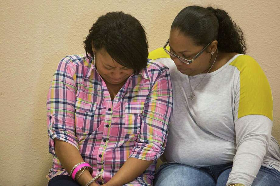 Charissa Sprawling-Mickles, right, comforts her sister Elena Sprawling-Scott during a news conference held at the Barbara Jordan Community Center about Antronie Scott's death in San Antonio on Feb. 6. Scott, who was unarmed, was shot and killed by a San Antonio police officer outside of his car as his wife, Elena Sprawling-Scott, watched from the passenger seat. Photo: Carolyn Van Houten /San Antonio Express-News / 2016 San Antonio Express-News