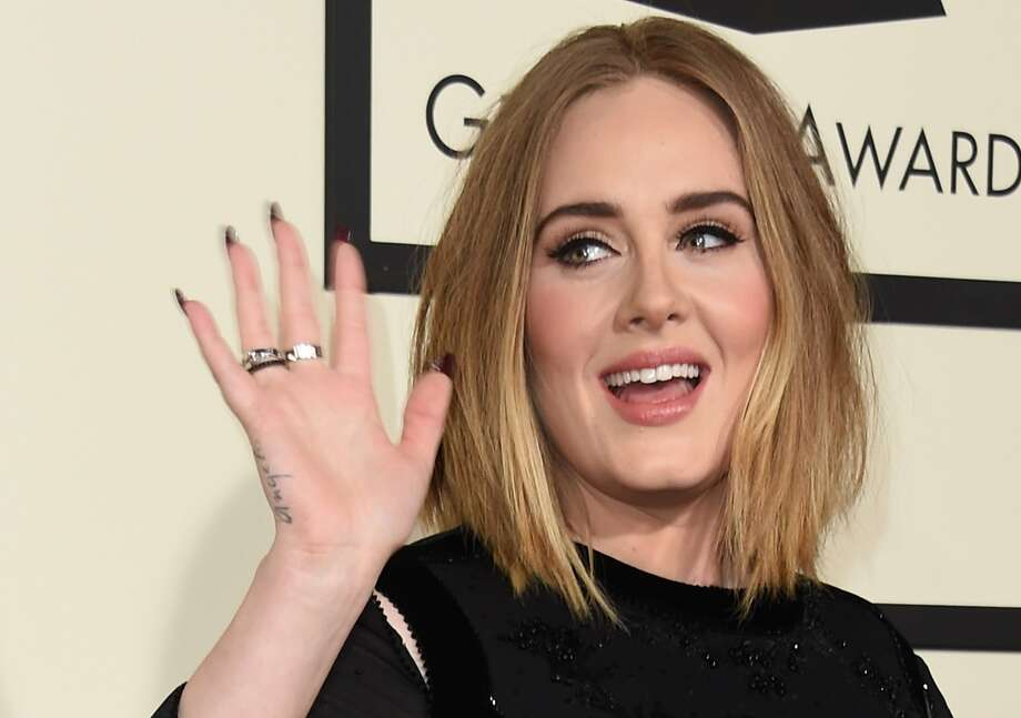 Singer Adele arrives on the red carpet during the 58th Annual Grammy Music Awards in Los Angeles February 15, 2016.  Photo: Valerie Macon, AFP / Getty Images