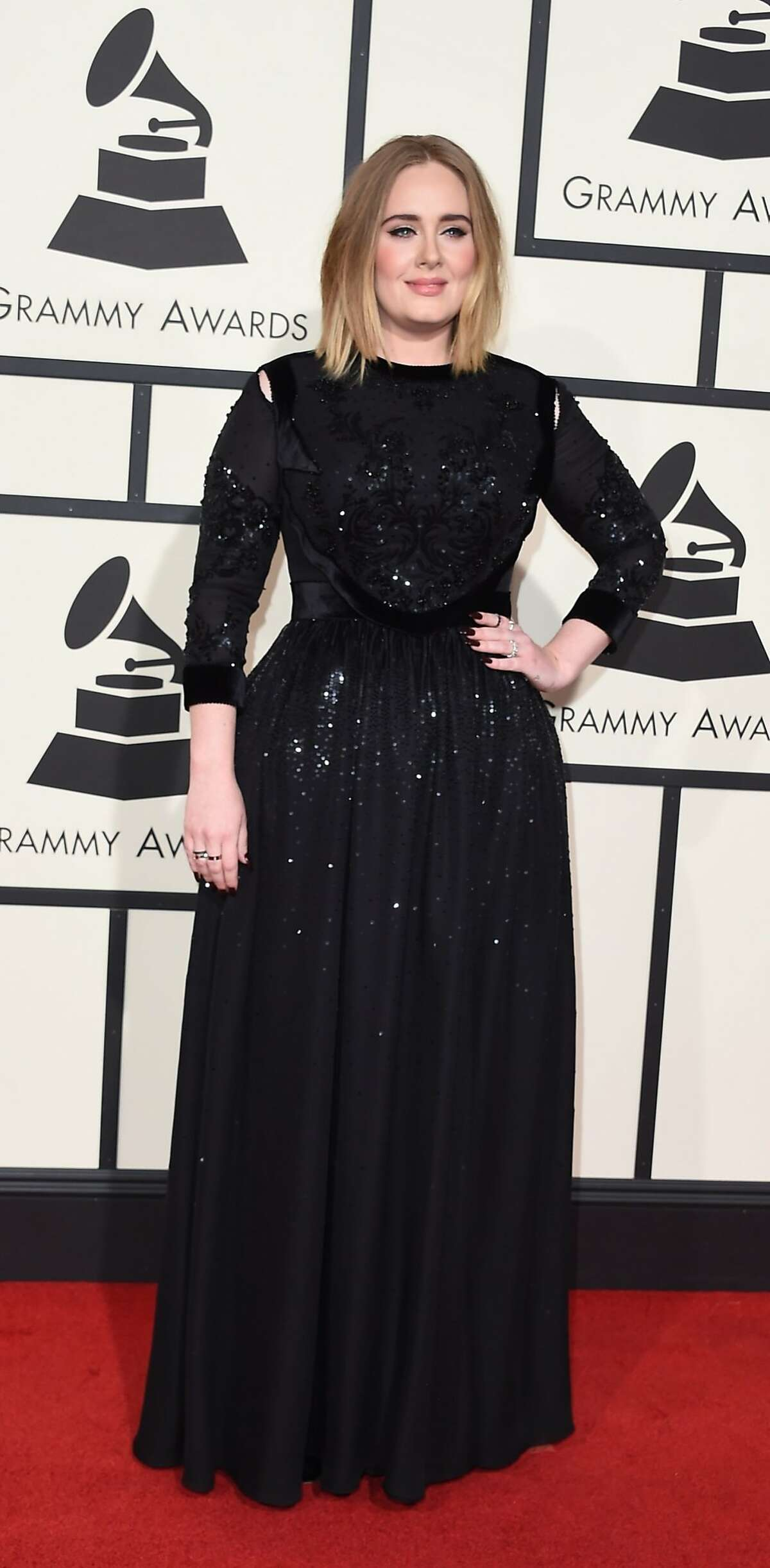 Singer Adele arrives on the red carpet during the 58th Annual Grammy Music Awards in Los Angeles February 15, 2016.