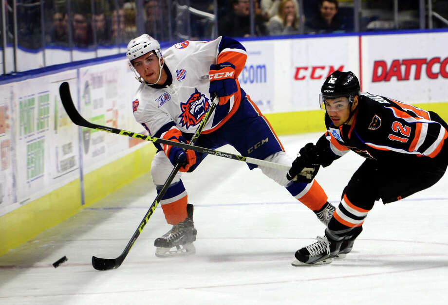 Sound Tigers Kyle Burroughs, left, 20, continues to adapt to the pace of the AHL. Photo: Christian Abraham / Hearst Connecticut Media / Connecticut Post