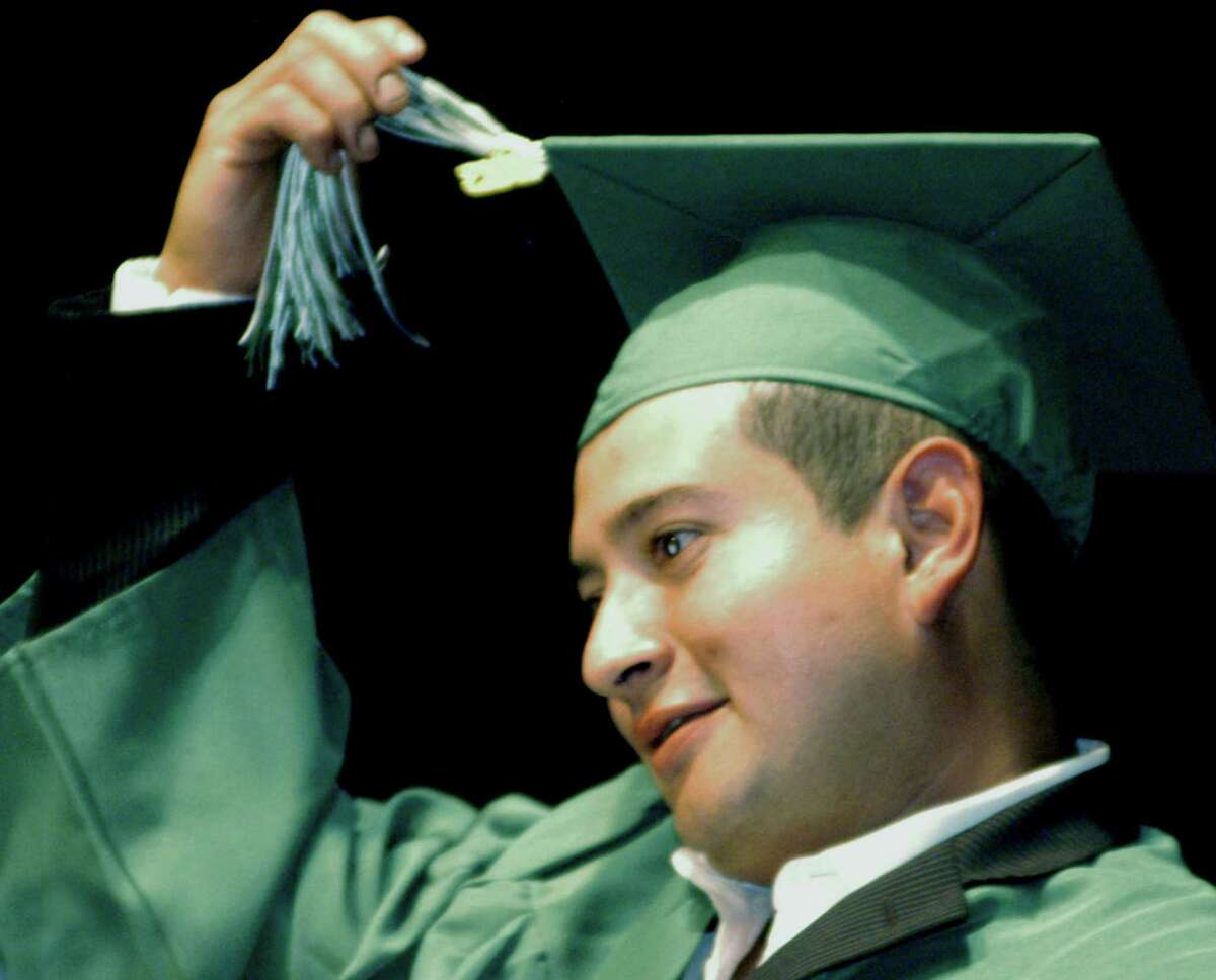 Edgardo Perez- Cabrera leads fellow New Milford High School adult- education graduates in 2013.