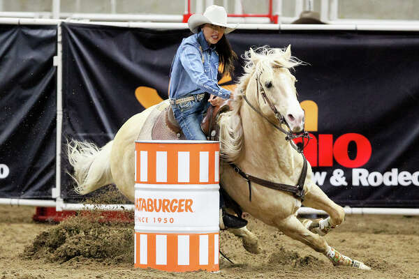 Barrel racer Jill Welsh from Parker, AZ, who has battled illnesses from arthritis to cancer, competes with Custer, her 11-year-old palamino gelding, in the San Antonio Stock Show and Rodeo on Sunday, Feb. 14, 2016, 2016.  MARVIN PFEIFFER/ mpfeiffer@express-news.net