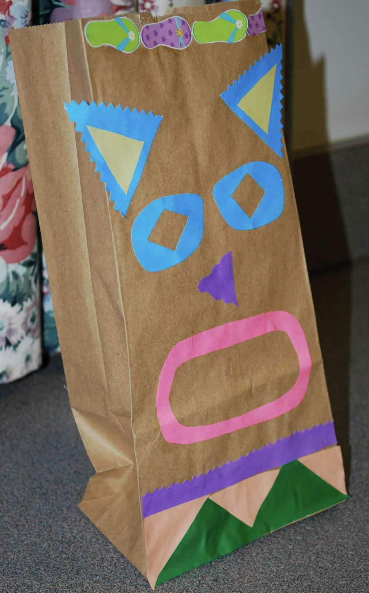 Spectrum/Colorful paper bags decorated for the occasion add a festive spirit to the First Congregational Church's Vacation Bible School program's Jan. 30, 2016, one-night luau-inspired event in New Milford.