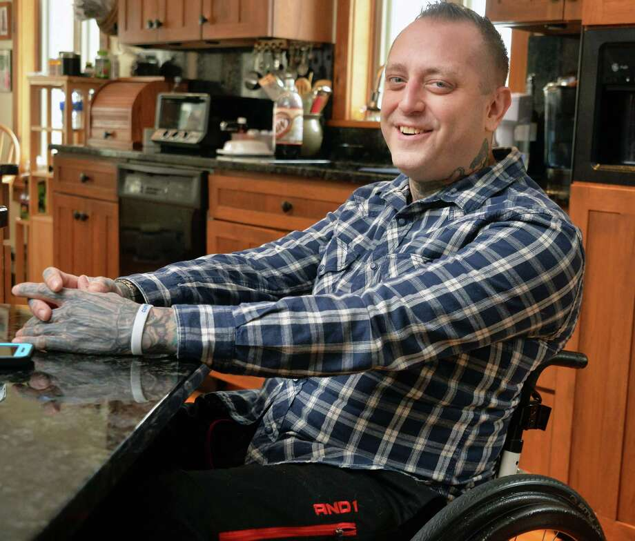 Dylan McDonnell discusses Friedreich's Ataxia (FA), a debilitating, degenerative, neuromuscular disorder that has left him in a wheelchair, on Friday, Feb. 12, 2016,during an interview at his home in Ganesvoort, N.Y.  (John Carl D'Annibale / Times Union) Photo: John Carl D'Annibale / 10035315A
