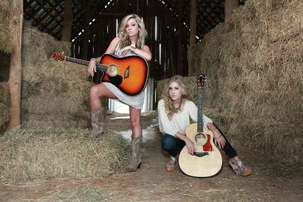 Country duo Maddie and Tae inked a publishing deal with Big Machine Records and are aiming to release an album next year. Taelyn Elizabeth, left, is from Ada, OK. Maddie Marlow is from Sugar Land. Photo by melindanorrisphotography.com.