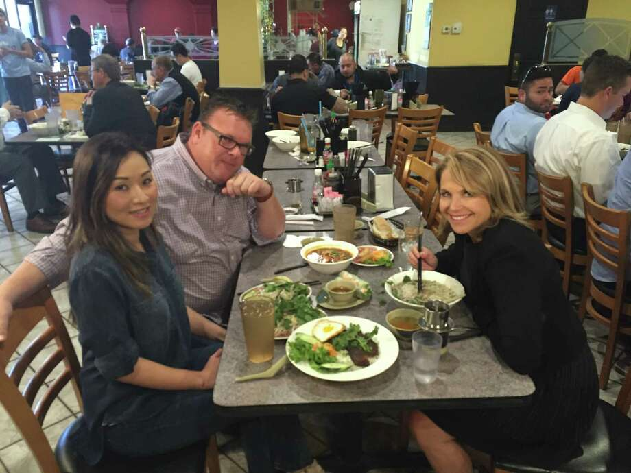 Underbelly chef Chris Shepherd took Katie Couric, right, global news anchor for Yahoo News, to Pho Saigon, owned by Mechelle Tran and one of his favorite restaurants, to sample Pho Tai and other Vietnamese dishes. Photo: Lindsey Brown