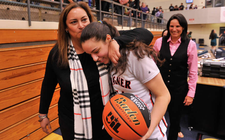 Wagner's Amber Ramirez is hugged by Denise Forrestier after surpassing Forestier for third place on the area girls all-time scoring list on Feb. 15, 2016. Looking on is Wagner coach Christina Camacho Photo: Robin Jerstad /San Antonio Express-News