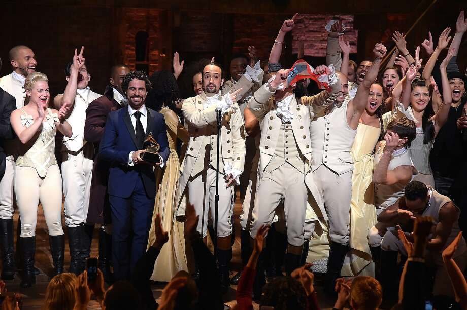 "Music director Alex Lacamoire and Actor, composer Lin-Manuel Miranda celebrate on stage during ""Hamilton"" GRAMMY performance for The 58th GRAMMY Awards at Richard Rodgers Theater on February 15, 2016 in Los Angeles City. Photo: Theo Wargo, WireImage"