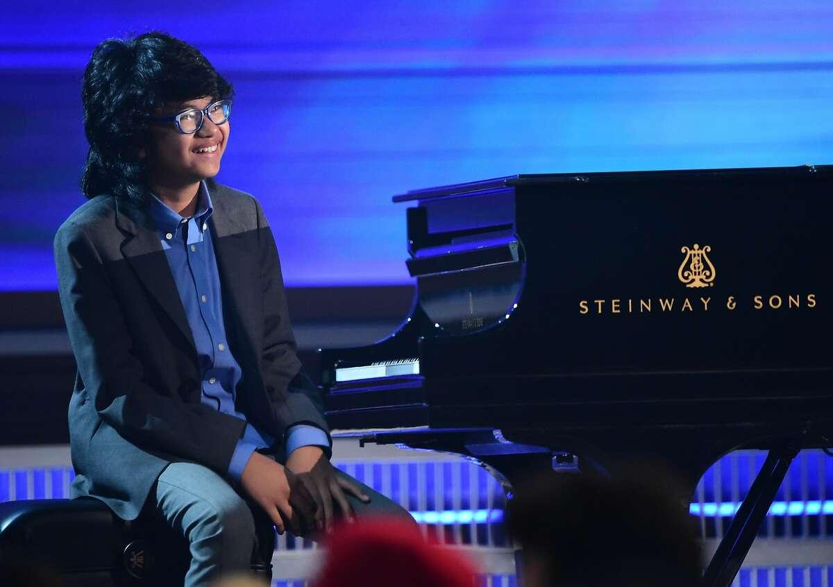 12 year old Jazz Pianist Joey Alexander performs onstage during the 58th Annual Grammy music Awards in Los Angeles February 15, 2016. AFP PHOTO/ ROBYN BECKROBYN BECK/AFP/Getty Images