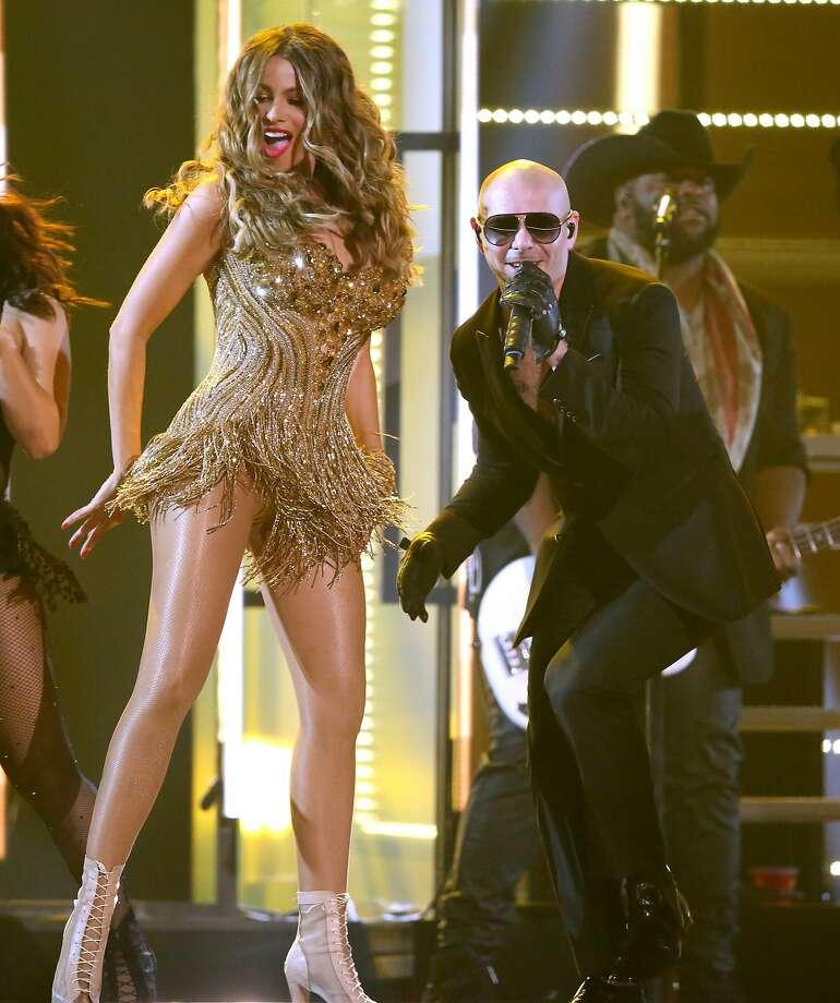 Sofia Vergara, left, and Pitbull perform at the 58th annual Grammy Awards on Monday, Feb. 15, 2016, in Los Angeles. (Photo by Matt Sayles/Invision/AP) Photo: Matt Sayles, Associated Press