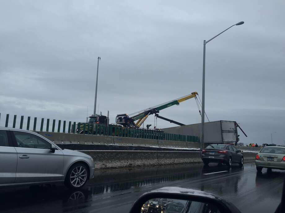 An overturned tractor-trailer closed northbound Interstate 95 in West Haven on Tuesday, Feb. 16, 2015.