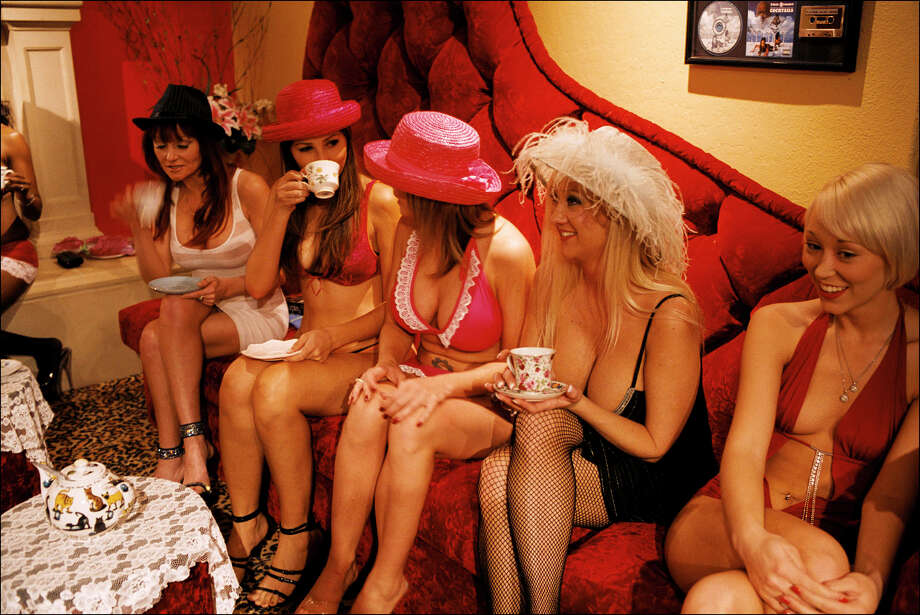 "INSIDE DENNIS HOF'S MOONLITE BUNNY RANCH:Tea time at the Moonlite Bunny Ranch, a legal brothel owned by Dennis Hof, in Lyon County, one of the fews counties in the USA which permits legalized prostitution. Madame Suzette, who likes to say that she ""manages the girls with an iron fist and a velvet glove"", is called ""Mom"" by the prostitutes. Every Thursday at 3pm, the working girls are having tea with their bosses Madame Suzette and Dennis Hof to go over some work stuff. Attendance is mandatory unless a client is in sight. Each prostitute from out of state works and sleeps in one of the brothel's 30 rooms during the entire duration of her stay. The local ones are allowed to go home after their shift. The Moonlite Bunny Ranch was featured in HBO reality TV show ""Cathouse: The Series"" between 2005 and 2007. Photo: Stephan Gladieu, Getty Images / 2008 Stephan Gladieu"