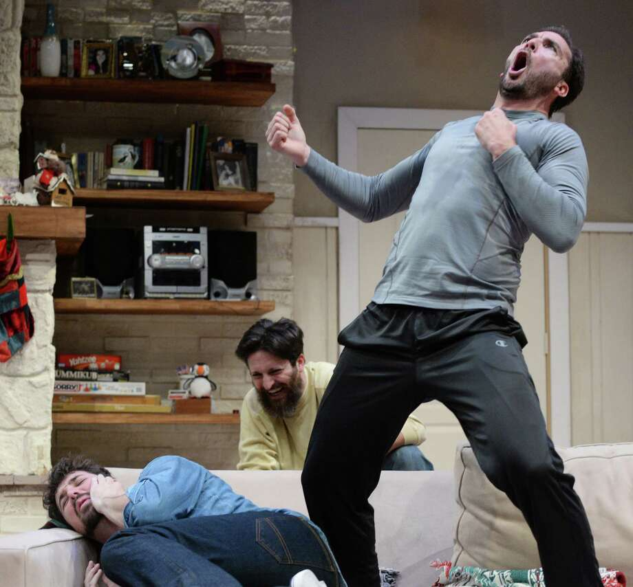 "David Matranga (bellowing), Adam Noble (chortling) and Jason Duga (suffering) play three brothers who horse around a lot in ""Straight White Men"" at Stages. Tuesday, Feb. 9, 2016, in Houston.  ( Jon Shapley / Houston Chronicle ) Photo: Jon Shapley, Staff / © 2015  Houston Chronicle"