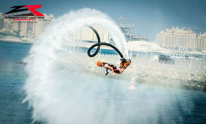 Competitors fly through the air at the Flyboard World Cup in Dubai in December 2015.
