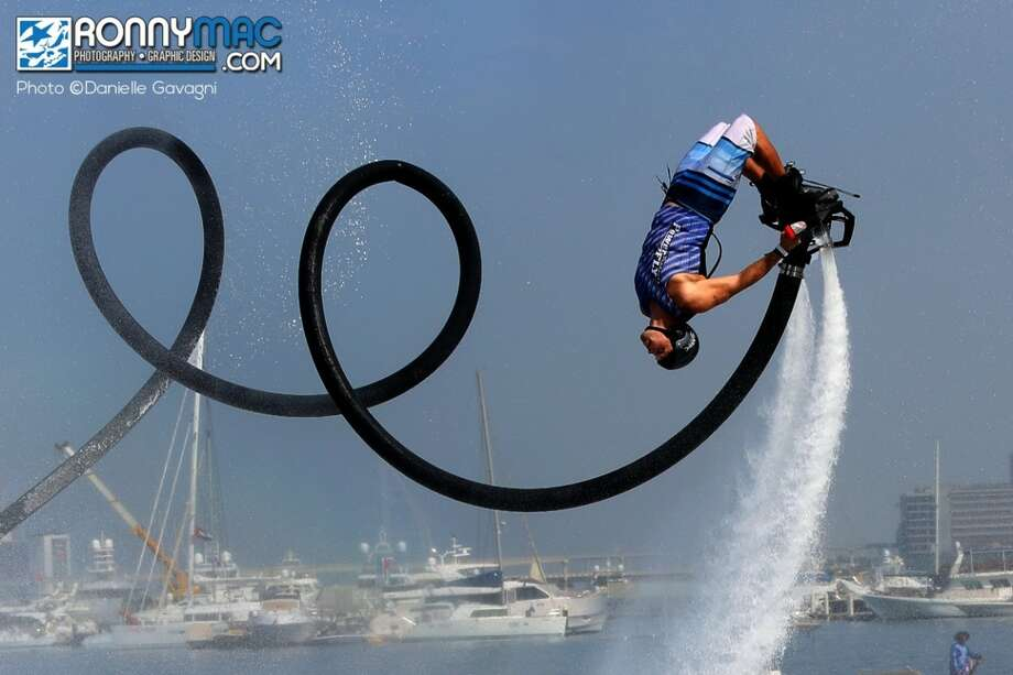 Competitors fly through the air at the Flyboard World Cup in Dubai in December 2015. Photo: Ronnie Mac/FlyCaptain
