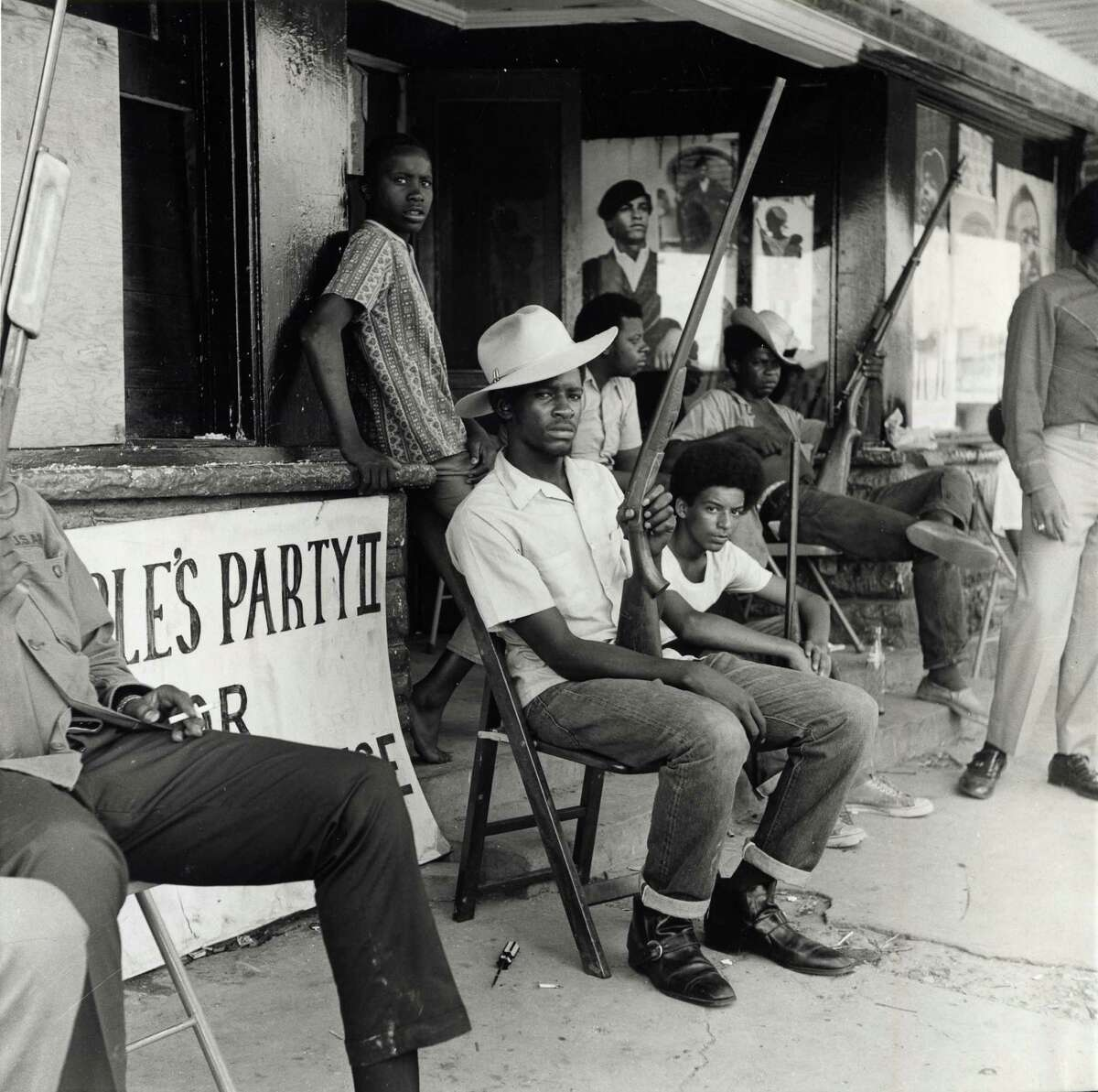 The scene outside the People's Party II headquarters, 2828 Dowling St., in July 1970, before a police shootout resulted in the death of Carl Hampton, the group's founder. (For more photos, of both the Houston and national movement, scroll through the gallery.)
