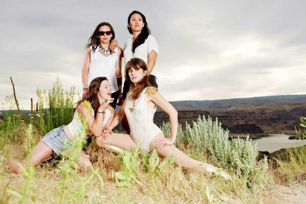 GEORGE, WA - May 27: Whitney Petty, Leah Julius, Lena Simon and Molly Sides of Thunderpussy pose for a portrait backstage at the Sasquatch! Music Festival at the Gorge Amphitheater on May 27, 2015 in George, Washington.