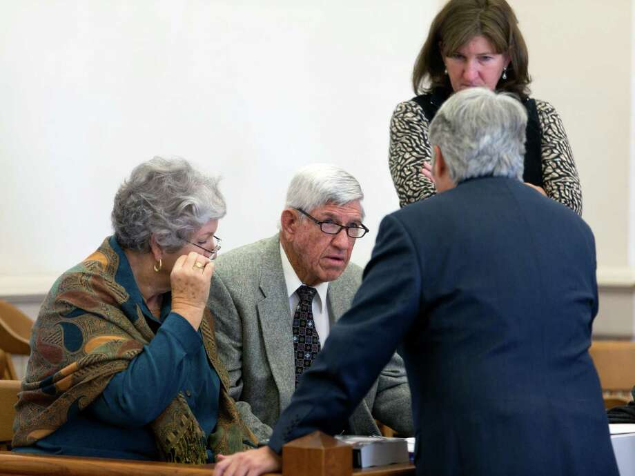 Glenn Bragg, center, his wife, JoLynn, left, and his daughter, Shelly, talk to one of their attorneys in the 38th District Court in Hondo last week. The Braggs successfully sued the Edwards Aquifer Authority, and a jury Monday awarded the family $2.5 million. Photo: William Luther /San Antonio Express-News / © 2016 San Antonio Express-News