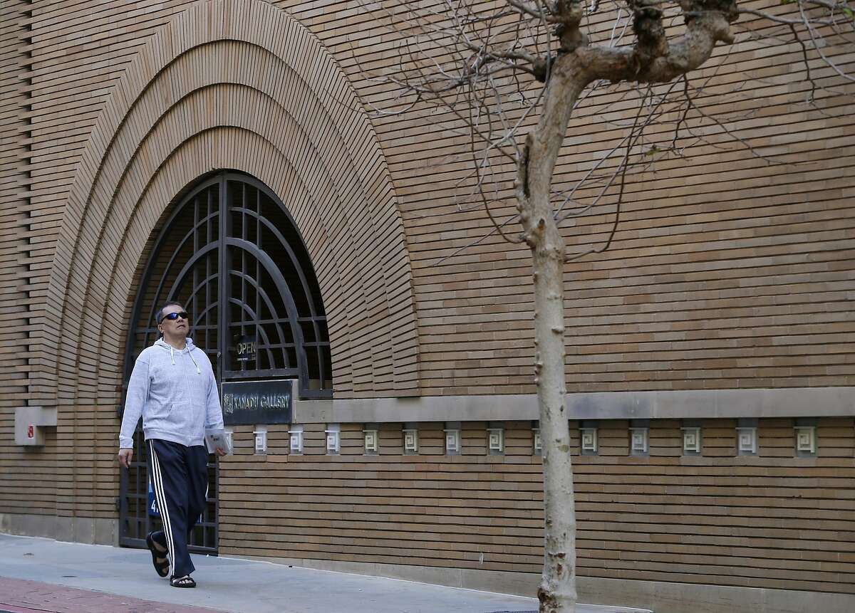 A man walks past a vacant building designed by architect Frank Lloyd Wright on Maiden Lane in San Francisco, Calif. on Tuesday, Feb. 16, 2016. Preservationists are seeking landmark status for its interior space.
