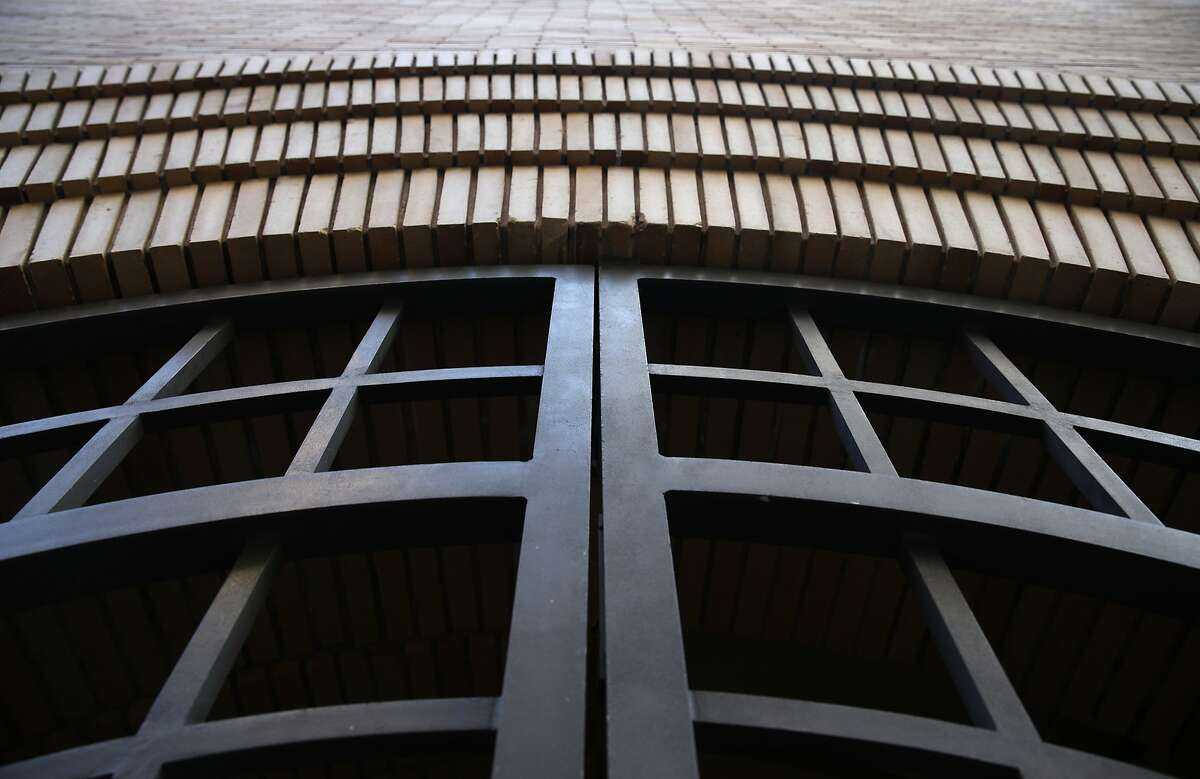 Arched bricks surround the gated entry to a vacant building designed by architect Frank Lloyd Wright on Maiden Lane in San Francisco, Calif. on Tuesday, Feb. 16, 2016. Preservationists are seeking landmark status for its interior space.