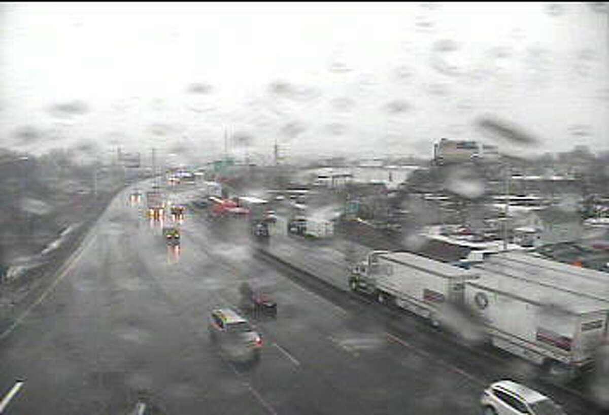 Traffic cameras show congestion around a tractor trailer rollover on Interstate 95 northbound. The crash happened near New Haven but traffic is backed up down to Milford.