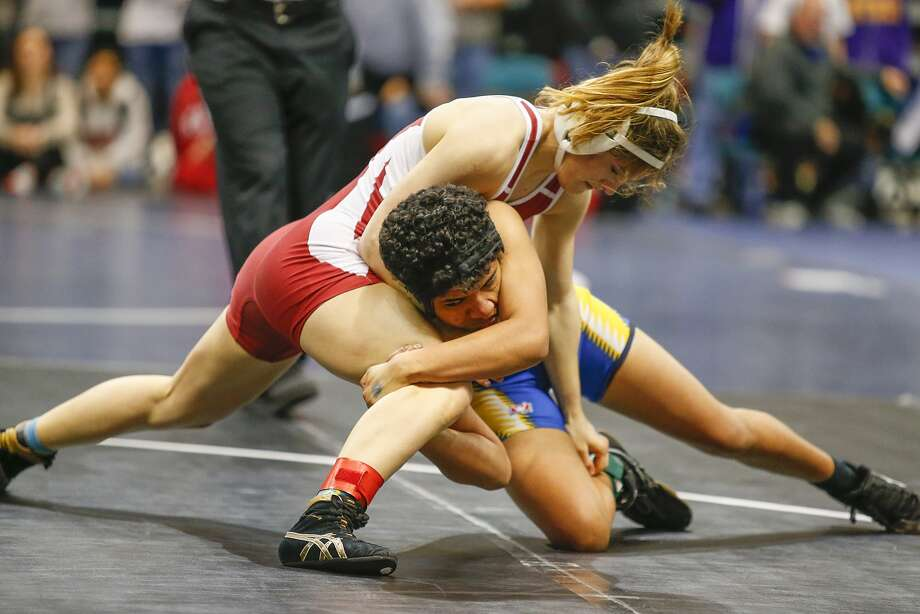 Cinco Ranch's Charlotte Fowler, top, gets above Xochitl Mota-Pettis of Klein in the championship round in the 110-lb. class in the 2016 UIL Region III-6A Girls Wrestling Tournament at the Merrell Center last week. Photo: Diana L. Porter, Freelance / © Diana L. Porter