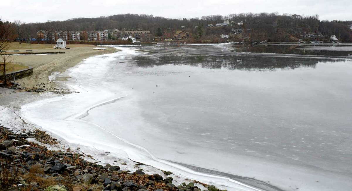 Connecticut lakes are warming, a trend seen around the world; this can mean fewer days being frozen over, resulting in more toxic blue-green algae blooms. Danbury's Candlewood Lake, pictured above, and Squantz Pond, in New Fairfield, have small sections of ice and open water in early February.